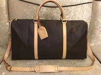 Männer Wandertasche 55cm Große Kapazität Frauen Reisetaschen Heißer Verkauf Hohe Qualität Schulter Duffelüten tragen Gepäckschlüssel mit Sperrkopf