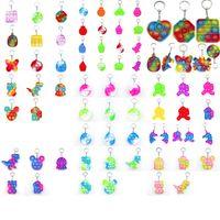 Fidget Pop It Brinquedo Festa Favor Sensory Jewelry Chaveiro Empurre Poo Sua bolha Poppers Dos Desenhos Animados Dimple Dimple Brinquedos Keychain Stress Reliever 2021