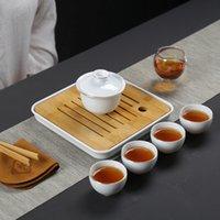 Juego de té de viaje de porcelana blanca dehua que representa el conjunto de regalo de alto grado de la taza de la taza de negocios Kungfu Set