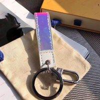 Luxurys عالية Peather Dazzle الألوان إلكتروني الطباعة الحلي المعدنية اليدوية للجنسين مصمم حلقة رئيسية مع مربع AA88