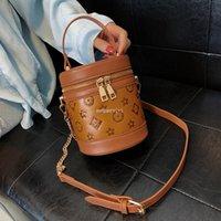 Luxury Kids metal chain circular handbags Designer girls PU lether one shoulder bags women mini bucket bag A3931