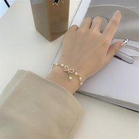 Süßer Strass-Bogen-Stern-Hochzeits-Armreif-Armband für Frauen-Mädchen-Paare Klassische Perlen-Kette Hand Schmuck Geschenke1