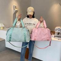 Duffel Bags Женщины нейлоновая сумка для путешествий Tote 2021 Сумочка Большой и небольшой размер плечо на выходные