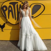 Other Wedding Dresses Hippie A-Line V Neck Floor Length Lace Tulle Beach Dress 2021 With Bowknot Ribbon1