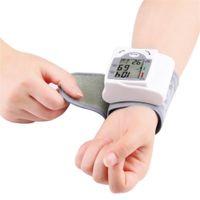 Portable Automatic Digital LCD Affichage du poignet Hariste de la pression artérielle Périphérique Taux de battement de coeur Compteur d'impulsion Mesurer Tonomètre Blanc