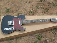 Electric guitar black body red tortoiseshell guard rose wood fingerboard
