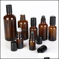 زجاجات الجرار التخزين تنظيم التدبير المنزلي الرئيسية حديقة 12pcs / lot العنبر الزجاج لفة على زجاجة زيتية عطرية فارغة مع الرولون المعدنية السوداء
