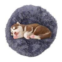 Kennels أقلام الكلب السرير مريحة أفخم جولة الحيوانات الأليفة للكلاب القطط الناعمة الفراء دونات المضادة للانزلاق للماء قاعدة سرير صغيرة كبيرة