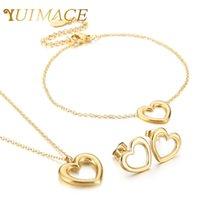 Einfache Frauen Armband Halskette Ohrringe Drei Stück Herzförmige Aushöhlen Hängende Kragen Set