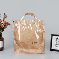 Wholesale waterproof and tear-resistant kraft paper bag shoulder bag new personality waterproof tote portable pvc shopping bag