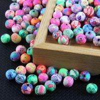 100 unids / bolsa 6 mm 8 mm 10 mm 12 mm Polímero Patrón de flores de arcilla Impresión redonda Perlas sueltas coloridas para la bracela Haciendo la joyería