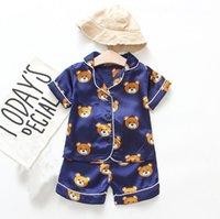 Diseñador niño niña pijamas oso home yoga conjuntos de yoga de dos piezas camisetas pantalones pantalones pantalones pantalones pijamas niñas niños dormir ropa de dormir de manga corta ropa de dormir para niños ropa de cama de bebé
