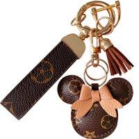Дизайн автомобиль брелок одолжение цветочная сумка кулон очарование ювелирных изделий брелок держатель для женщин мужчин подарок мода искусственная кожа животных брелок