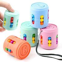 減圧玩具コーラはキューブの指のおもちゃ子供の創造的な楽しさ魔法のビーズ知的回転ゲーム