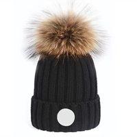 Оптовая продажа высокого качества зимние колпачки шляпы женщин и мужчин шаполообразны с реальными помпами еноты из енотных помпонов теплые девушки кепки Snapback Pompon Beanie