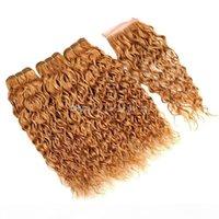 Pelo virgen brasileño Húmedo ondulado 27 # coloreado rubio cabello humano 3 paquetes con cierre miel ola de agua rubia tejidos con cierre de encaje 4x4