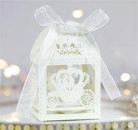 Venta al por mayor- 2016 50 unids Blanco Corte de láser Encantado Caja de matrimonio, carro de calabaza Favor de boda Cajas de regalo Caja de regalo Caja de caramelo 712 K2