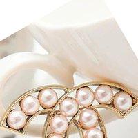 Diseñador letra broches elegante arco aleación cristal broche ropa ropa prostitudes trajes accesorios pin joyería