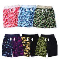 2021 pantalones cortos para hombres Mujeres Camuflaje Pantalones de playa Secado rápido Graffiti Estampado Leggings Natación Trunks Hip-Hop Luminoso Casual Street con Labe
