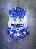 Australia Zim Palacio estilo azul y blanco porcelana impresa camisa suelta + juego corto