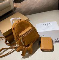 2021 Luxurys Designers Mochilas Estilo com Carteira Moda Mulher Letra Senhora Composto Bag Schoolbag Unisex Mini Sacos Sacos