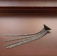 Heiße neue europäische und amerikanische übertriebene übertriebene lange große Marke voller Diamant-Quaste Ohrringe weibliche Ohrringe Temperament Französische Ohrringe Freies Shipp
