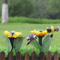 24 часа доставки !! Садовые украшения Солнечная энергия Танцы Летающие Бабочки Будут развевающиеся вибрационные муха Колибри Смешные игрушки GYQ