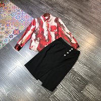 Light and mature fashion print shirt set spring 2021 new women's fashion western half skirt two pieces