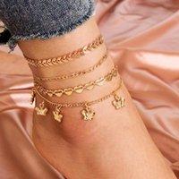 Anklets Modyle 4pcs / Set Vintage Boho Style Gold Chain Design Coeur Coeur Arrow Butterfly ANKLET POUR FEMME Vente en gros