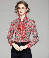 2021 Nouveau designer Imprimé Dames Bow Chemises Bouton Piste Vintage Bouton Femme Blouses Longues Manches Spring Spring Automne Élégante Shirt Office Casual Tops