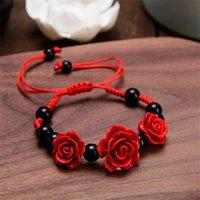Blocco, fili di modo delle donne delle donne del braccialetto della rosa del braccialetto etnico della lacca dell'artigianato etnico Fiore del cinabro scolpito per la corda rossa perline