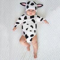 Rompers рожденные младенческие девочки девочек мальчики боди полов коровьей печати длинные умывальники весна осень мультфильм ушные шляпы наряды одежда 0-24м