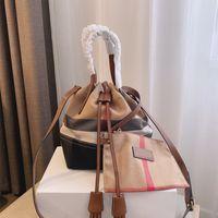 Canevas plaid sac à main classique sac de godet de godet de la mode composite mode de bandoulière en cuir véritable cuillère en cuir à linge étanche Land Bandoulière