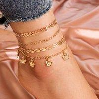 MODYLE 4PCS / SET VINTAGE BOHO Style Gold Chain Anklets Design Coeur Coeur Arrow Butterfly Anklet pour femme Vente en gros