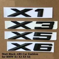 1PC ABS Matt Car emblème Logo Logo Badge Trunne Trunk Autocollant Accessoires pour BMW X1 E84 F48 X3 F25 G01 X5 E70 F15 X6 F16 E71 G06