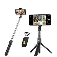 K07 بلوتوث اللاسلكية selfie عصا طوي المحمولة monopods مصراع النائية قابل للتمديد ميني ترايبود للهاتف الذكي