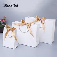 10pcs 선물 가방 선물 종이 가방 리본 결혼식 팩 상자 호의 생일 파티 가방 / 잠옷 옷 가발 포장