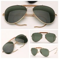 Hombres al aire libre Gafas de sol Moda para mujer Gafas de sol Piloto Gafas de sol Aviación Lentes de protección UV Protección de lentes de vidrio con paquete al por menor