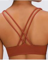 2078 الأزياء الحرة لتكون القمصان الصدرية على الخط على ly رياضة سترة رفع اللياقة البدنية قمم مثير سيدة قمم اليوغا الصدرية