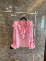 Blusa de gasa Pink Silk Verano 2021 V-cuello en V Ruffle Jabot Mangas largas Flunces Bordado Sicilia Pista de lujo con volantes Famosos EFME