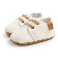 Первые ходунки рожденные детские кроватки обувь противоскользящей мягкой подошвой кожи плоский ботинок сплошной цветовой скольжения на повседневную кроссовку Уокер для
