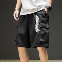 Pantaloncini da uomo a corto di cargo allentato a mezza pantaloni Tide Streetwear Casual Summer Men Moda Big Pocket Cotton Sports Beach Pants 3XL