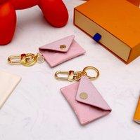 Дизайнер Unisex Письмо Уолковидная ключей брелок Мода Кошелек Подвесной Автомобильные Чай Очарование Розовый Цветок Мини Сумка Блестящие Подарки Аксессуары