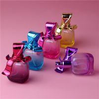 DHL Free 50 pcs 15ml 3D Creative Bow Recarregável Portátil Mini Perfume Viajante Viajante de Vidro Spray Atomizador Vazio Parfum Garrafa