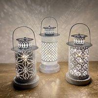 Linternas de viento huecas Hierro Craft Hueco Decorativo Candlestick LED Vela Luces DIY Festival Partido Decoración para el hogar DWA4029