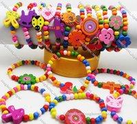 50pcs Kids Girls Wood Bracelets Children Wristbands 12 design Mix Wholesale Birthday Party Gift Jewelry Lot