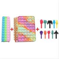 Cajas de lápiz Notebooks Favor Bubble Fidget Push Up Ding Finger Pen Cap Bloc de notas Estudiante Decomresión Suministros de papelería para niños DHL gratis CO27