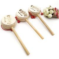 Giocattolo musicale del fumetto naturale del fumetto giocattolo musicale cinese tradizionale a forma di tamburo a forma di mantello della mano Bell Bambino Giocattoli educativi primitivi 1 15yn Y2