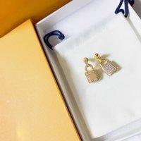 Blocco orecchini Charm per le donne Moda cuore pendente orecchino signore gioielli lettere designer anello orecchio con scatola