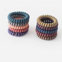 Mujeres Mezclar colores Teléfono Cable de goma Bandas Espirales Cuerdas de Bobinas Sólidas